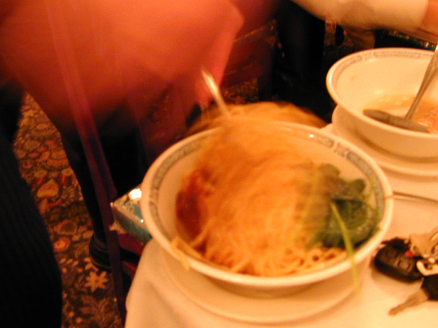 Spicy Noodles 2: The waiter is mixing up the spicy noodles, but the shutter speed is so slow he's just a blur.